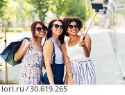 Купить «women with shopping bags taking selfie outdoors», фото № 30619265, снято 22 июля 2018 г. (c) Syda Productions / Фотобанк Лори