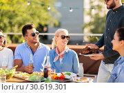 Купить «friends at bbq party on rooftop in summer», фото № 30619301, снято 2 сентября 2018 г. (c) Syda Productions / Фотобанк Лори