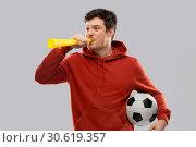 Купить «football fan with soccer ball blowing horn», фото № 30619357, снято 3 февраля 2019 г. (c) Syda Productions / Фотобанк Лори