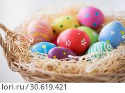 Купить «close up of colored easter eggs in basket», фото № 30619421, снято 15 марта 2018 г. (c) Syda Productions / Фотобанк Лори