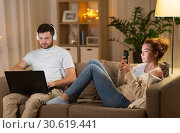 Купить «couple with laptop and smartphone resting at home», фото № 30619441, снято 5 января 2019 г. (c) Syda Productions / Фотобанк Лори