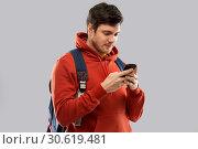 Купить «man or student with smartphone and school bag», фото № 30619481, снято 3 февраля 2019 г. (c) Syda Productions / Фотобанк Лори