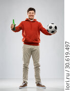 Купить «man or football fan with soccer ball and beer», фото № 30619497, снято 3 февраля 2019 г. (c) Syda Productions / Фотобанк Лори