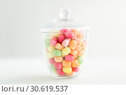 Купить «glass jar with candy drops over white background», фото № 30619537, снято 6 июля 2018 г. (c) Syda Productions / Фотобанк Лори