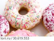 Купить «close up of glazed donuts on white table», фото № 30619553, снято 6 июля 2018 г. (c) Syda Productions / Фотобанк Лори