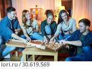 Купить «friends eating pizza and drinking red wine at home», фото № 30619569, снято 22 декабря 2018 г. (c) Syda Productions / Фотобанк Лори