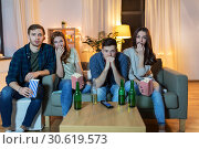 Купить «friends with beer and popcorn watching tv at home», фото № 30619573, снято 22 декабря 2018 г. (c) Syda Productions / Фотобанк Лори