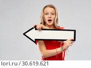 Купить «teenage girl with arrow showing direction», фото № 30619621, снято 17 февраля 2019 г. (c) Syda Productions / Фотобанк Лори
