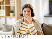 Купить «sick woman in blanket coughing at home», фото № 30619641, снято 6 марта 2019 г. (c) Syda Productions / Фотобанк Лори