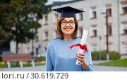 Купить «happy senior graduate student woman with diploma», фото № 30619729, снято 8 февраля 2019 г. (c) Syda Productions / Фотобанк Лори