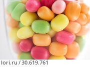 Купить «close up of glass jar with colorful candy drops», фото № 30619761, снято 6 июля 2018 г. (c) Syda Productions / Фотобанк Лори