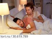 Купить «woman wakes her sleeping husband up in bed at home», фото № 30619789, снято 5 января 2019 г. (c) Syda Productions / Фотобанк Лори