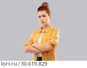 Купить «serious red haired teenage girl with crossed arms», фото № 30619829, снято 28 февраля 2019 г. (c) Syda Productions / Фотобанк Лори