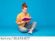 Купить «happy teenage student girl with diary or notebook», фото № 30619877, снято 28 февраля 2019 г. (c) Syda Productions / Фотобанк Лори