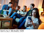 Купить «young woman with smartphone at home party», фото № 30620109, снято 22 декабря 2018 г. (c) Syda Productions / Фотобанк Лори