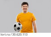 Купить «happy man or football fan with soccer ball», фото № 30620113, снято 3 февраля 2019 г. (c) Syda Productions / Фотобанк Лори