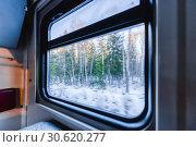 Купить «View of the window of a moving passenger train.», фото № 30620277, снято 6 марта 2019 г. (c) Андрей Радченко / Фотобанк Лори