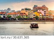 Купить «Boat and Cityscape in Singapore.», фото № 30631365, снято 18 августа 2017 г. (c) easy Fotostock / Фотобанк Лори