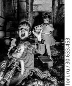 Creepy children and scary dolls in the barn. Стоковое фото, фотограф sumners / easy Fotostock / Фотобанк Лори