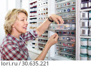 Купить «Female next to shelf with buttons», фото № 30635221, снято 23 мая 2019 г. (c) Яков Филимонов / Фотобанк Лори