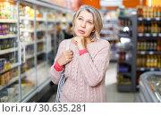 Купить «woman visiting supermarket food department», фото № 30635281, снято 8 февраля 2019 г. (c) Яков Филимонов / Фотобанк Лори