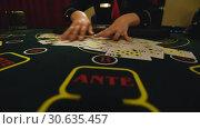 Купить «Casino stickman takes the cards», видеоролик № 30635457, снято 23 апреля 2019 г. (c) Jan Jack Russo Media / Фотобанк Лори