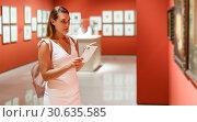 Купить «Woman visiting painting exhibition», фото № 30635585, снято 28 июля 2018 г. (c) Яков Филимонов / Фотобанк Лори