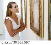 Купить «Woman visiting painting exhibition», фото № 30635597, снято 28 июля 2018 г. (c) Яков Филимонов / Фотобанк Лори