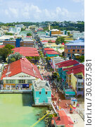Купить «St. John's Antigua is the capital and largest city of Antigua and Barbuda, located in the West Indies in the Caribbean Sea and with a population of 22...», фото № 30637581, снято 22 января 2019 г. (c) age Fotostock / Фотобанк Лори