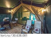 Купить «A luxurious tent cabin in Maasai Mara National Reserve, Kenya.», фото № 30638081, снято 25 января 2019 г. (c) age Fotostock / Фотобанк Лори