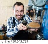 Купить «Male worker repairing shoe», фото № 30643789, снято 2 февраля 2017 г. (c) Яков Филимонов / Фотобанк Лори