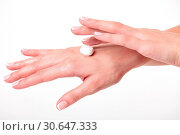 Купить «Closeup shot of beautiful woman's hands with cream, white backgr», фото № 30647333, снято 22 ноября 2017 г. (c) easy Fotostock / Фотобанк Лори
