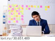 Купить «Young handsome employee in front of whiteboard with to-do list», фото № 30651489, снято 16 октября 2018 г. (c) Elnur / Фотобанк Лори