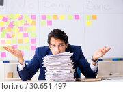 Купить «Young handsome employee in front of whiteboard with to-do list», фото № 30651497, снято 16 октября 2018 г. (c) Elnur / Фотобанк Лори