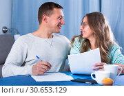 Купить «Couple signing papers», фото № 30653129, снято 18 марта 2017 г. (c) Яков Филимонов / Фотобанк Лори