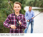 Portrait of happy boy casting line for fishing. Стоковое фото, фотограф Яков Филимонов / Фотобанк Лори