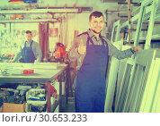 Купить «professional labours with finished PVC profiles and windows», фото № 30653233, снято 30 марта 2017 г. (c) Яков Филимонов / Фотобанк Лори