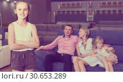 Купить «Young girl 7-10 years old is happyning of new sofa», фото № 30653289, снято 3 июля 2017 г. (c) Яков Филимонов / Фотобанк Лори