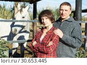 Купить «Man and woman at horse stable», фото № 30653445, снято 26 ноября 2018 г. (c) Яков Филимонов / Фотобанк Лори
