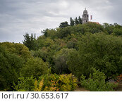 Купить «Low angle view of hilltop church surrounded with trees, Karce, Trivet, Montenegro», фото № 30653617, снято 17 ноября 2019 г. (c) Ingram Publishing / Фотобанк Лори