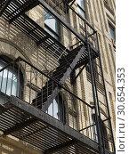 Купить «Low angle view of fire escape on exterior of a building, New York City, New York State, USA», фото № 30654353, снято 18 февраля 2020 г. (c) Ingram Publishing / Фотобанк Лори