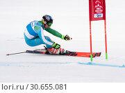 Купить «Горнолыжник Тухтаев Комилжон (Komiljon Tukhtaev) (Узбекистан). Соревнования Международной федерации лыжного спорта, слалом-гигант», фото № 30655081, снято 2 апреля 2019 г. (c) А. А. Пирагис / Фотобанк Лори