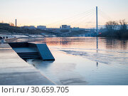 Купить «Tyumen, Russia, on April 19, 2019: A spring high water on the embankment in Tyumen in the evening», фото № 30659705, снято 19 апреля 2019 г. (c) Землянникова Вероника / Фотобанк Лори