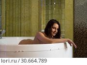 Купить «Nude female in bathtub in sauna», фото № 30664789, снято 16 декабря 2019 г. (c) Гурьянов Андрей / Фотобанк Лори