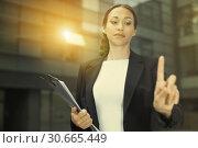 Купить «Female office manager is asking companion to wait», фото № 30665449, снято 26 июня 2017 г. (c) Яков Филимонов / Фотобанк Лори