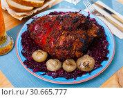 Купить «Juicy baked in beer pork knuckle», фото № 30665777, снято 23 июля 2019 г. (c) Яков Филимонов / Фотобанк Лори