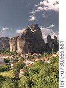 Купить «Kastraki village in Meteora mountains, Greece», фото № 30666681, снято 4 июля 2018 г. (c) Sergii Zarev / Фотобанк Лори