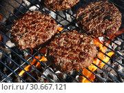 Купить «Beef burger for hamburger on barbecue flame grill», фото № 30667121, снято 9 июня 2018 г. (c) Anton Eine / Фотобанк Лори