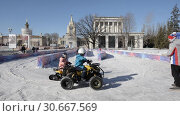 Купить «Children's attraction in the park VDNH. Children ride electric cars and snowmobiles.», видеоролик № 30667569, снято 16 февраля 2019 г. (c) Андрей Радченко / Фотобанк Лори