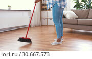 Купить «woman with sweeping broom brush cleaning floor», видеоролик № 30667573, снято 15 апреля 2019 г. (c) Syda Productions / Фотобанк Лори